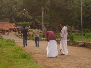 This one taken on the way to the temple... PV trying to adjust his dhothi.. with some expert tips from my father.. :)) myself n chandu r marching forward without any problems :D