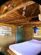Roof bedroom of a 'banda', Diamond Beach Village, Manda Island, East Coast, Kenya