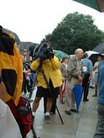 people being photographed or taped or interviewed everywhere
