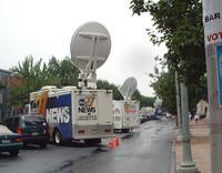 lotsa news trucks