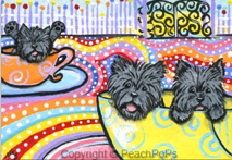 Cairn Terrier dogs on spinning tea cup ride
