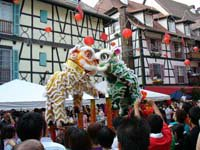 Lion dance at the Bukit Tinggi Colmar Tropicale, the mock French town replica.