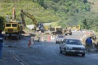One lane at Km13 of the Kampung Raja-Pos Slim road being cleared for traffic at 6am yesterday. A mudslide made the road impassable on Tuesday.