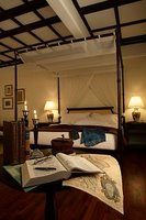 Expect a four-poster bed and cosy settees in the luxurious room.