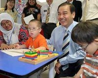 """SHARED MOMENT: Chan spending time with five-year-old Lim Wei Kang after launching the 23rd Kiwanis """"Chill Out"""" Treasure Hunt 2006 in Petaling Jaya yesterday."""