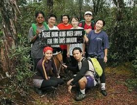 The group of Malaysian Nature Society Members took a breather<br />while on their way to the summit of Gunung Benom.</