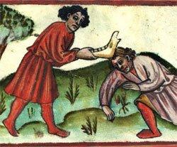Caín mata a Abel con una quijada de burro que encontró allí al lado