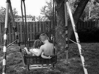 Children on swing in neat yard