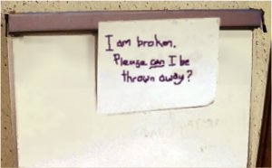 Note on a flipchart: I am broken. please can I be thrown away?