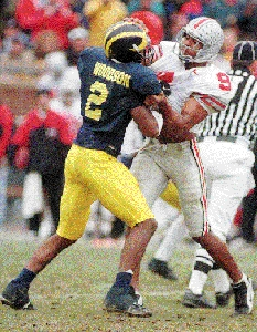 Charles Woodson roughs up David Boston