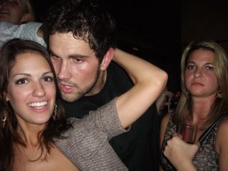The chick Leinart is hitting on looks pretty hot, but that blond chick in the background, she's pissed.  Once this story spreads across the internet she's going to be more embarrassed by her mean-mug than Leinart