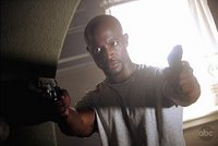 Taye Diggs locked and loaded