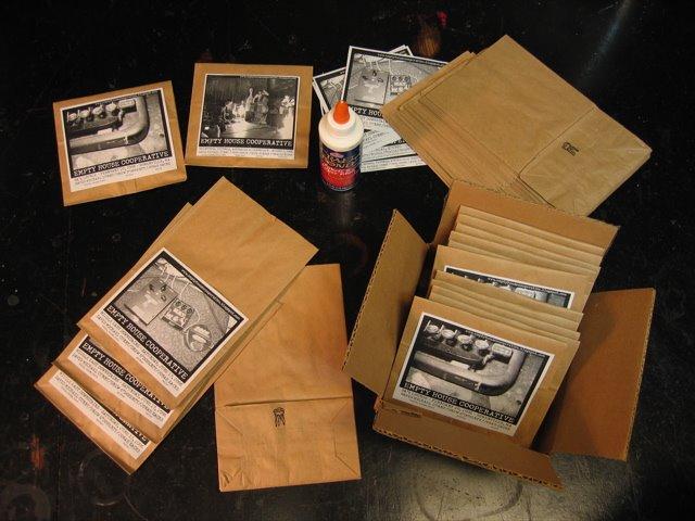 DMC's DIY paper lunch bag CD covers.
