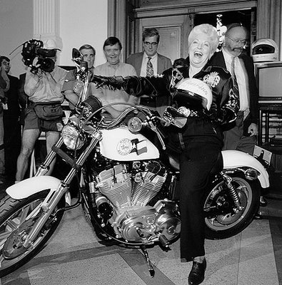 image:Ann Richards on bike from the Texas state library archive, b&w photo