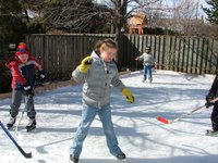 Kate getting into the backyard hockey action