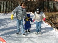 Helping Lukey to skate.  They start 'em young!