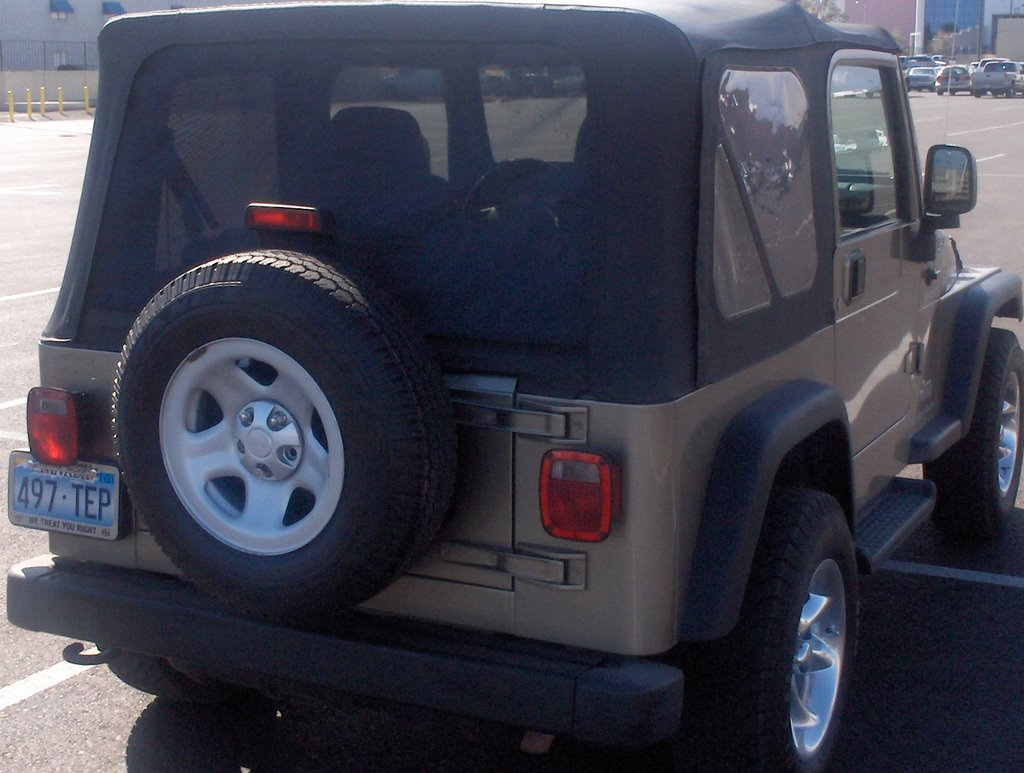 Thermacoustic Solar Screening Systems Install Jeep Rear Window With System