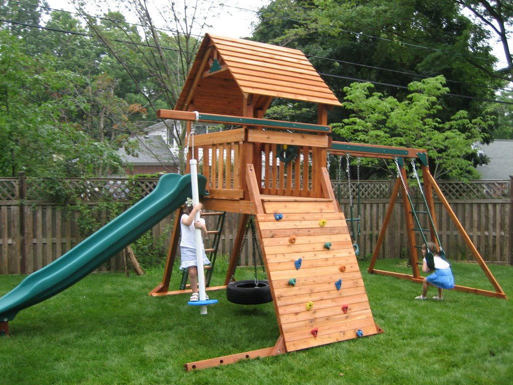 think this world is perfect the swing set ate our backyard