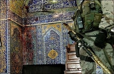 A soldier on guard inside Buratha mosque after today's bombing