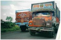 Trucks on Ratlam Highway. Used with permission courtesy of Women Make Movies (www.wmm.com).