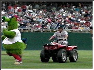 Damon chases the Phillies mascot