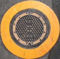 Fire extinguisher manhole cover in Minato ward, Tokyo.