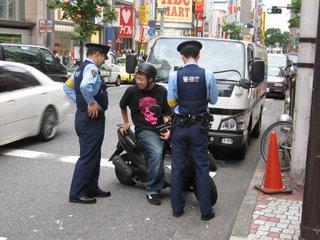Police checking a motorcyclist, Shibuya, Tokyo.