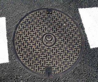 NTT communications manhole cover, Minato ward, Tokyo.