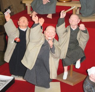 Merry old men figurines.