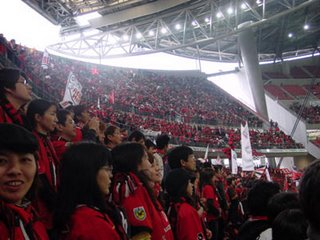 Urawa supporters off to the side of the hard-core fans