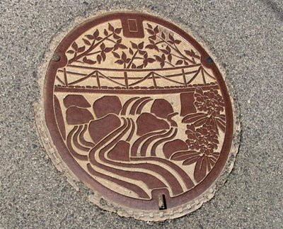 Water Manhole. Izumo-Minari, Shimane. The image depicts a bridge over the Hii river
