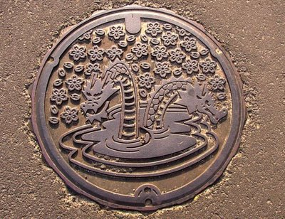 Drain. Kisuki Town, Shimane. Home of the Orochi legend, images of the 8-headed serpent are everywhere