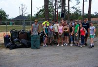 Team with the junk they cleaned from the park