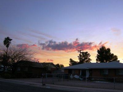 sunset over  a neighbor's house
