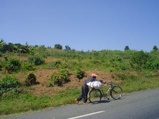 man going uphill on a bicycle