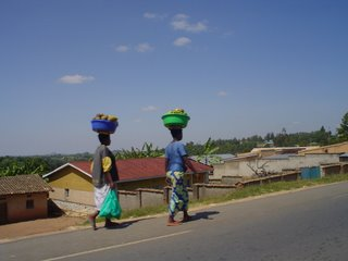 two women balancing lots of things on their heads