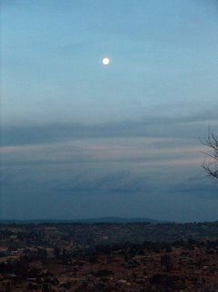 moon in twilight over Kigali