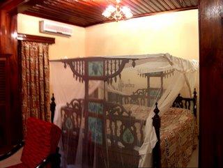 huge bed in a fancy Zanzibari bedroom