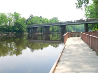 view of Freeland Road bridge across the Tittabawassee River from the lowest level fishing dock