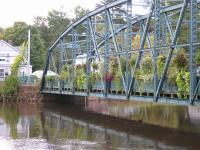 Simsbury, CT -- Footbridge over Farmington River on 10/17/2005, two days after nine days of continuous rain.