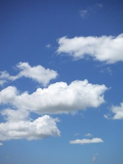 Photo by Deirdre: happy white clouds in a springtime blue sky