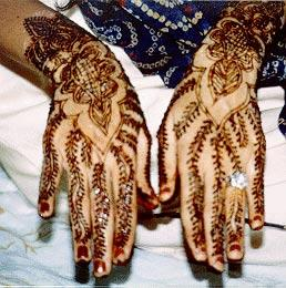 Actually It Looks A Lot Like This Picture I Found On Tunisian Wedding Gown Website Also Her Hands Were Painted With Henna In An Elaborate Design