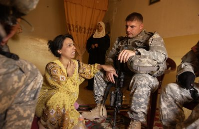 Lt. Michael McCave consoles a widow with four children in Kirkuk, Iraq