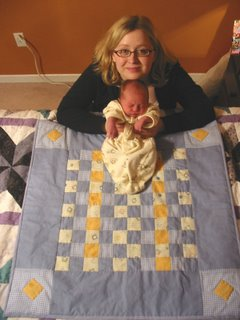 Max and Mom on the quilt Aunt Jennifer made.