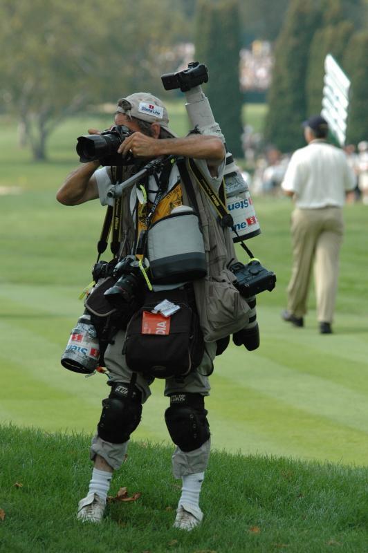 Overburdened photographer