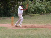 Old Scout Aloka Perera Trying Hard with Bat