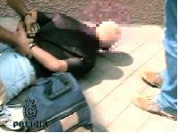 One of the arrested men detained during Operacion 'Hench' on Thursday 26 August 2005, being immobilised.