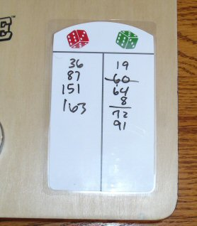 Whupped again by my kid sister.  She insisted on tallying my abyssmal final score before I snapped this picture.