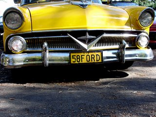 yellow old ford car