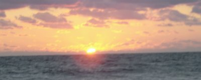 Sunset photograph copyright 2006 by Charmaine Lydon; shows a panoramic cloudy sunset over the ocean.